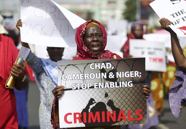 Woman holding signs take part in a protest demanding the release of abducted secondary school girls from the remote village of Chibok, in Lagos
